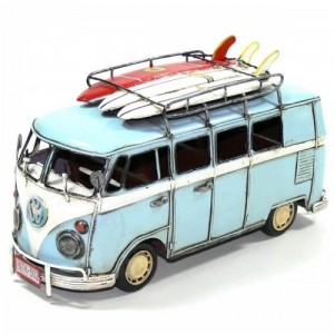 BLUE VW VAN WITH SURFBOARDS